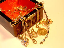 Jewelry Box with Gold and Gemstones. Gold, diamonds and gems in lovely wooden box Stock Photo