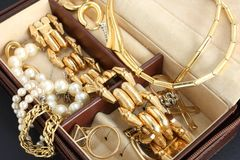 Jewelry box with jewelry. Close-up of some jewerly inside a nice jewelry box Stock Photos