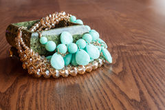 Jewelry box and jewelry on a wooden background Royalty Free Stock Photography