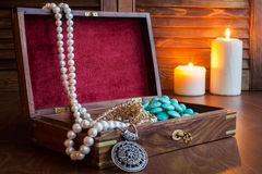 Jewelry box and jewelry on a wooden background Royalty Free Stock Photos