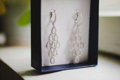 Jewelry box with luxury wedding earrings. Wedding Royalty Free Stock Photography
