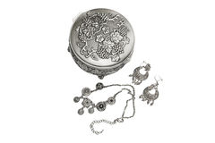 Jewelry box with necklace and earrings. On white royalty free stock photography