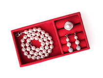Jewelry box with pearl necklace, ring and ear Stock Image