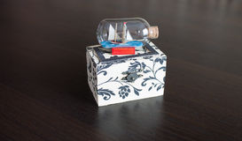 Jewelry box with ship in  abottle Stock Images