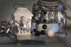 Jewelry box and silver santa. On the table royalty free stock photos