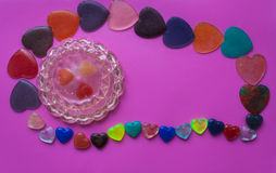 Jewelry box surrounded by hearts on pink-purple background. Vale. Jewelry box with hearts and hearts of epoxy resin. Pink background. Valentine`s Day postcard Royalty Free Stock Photo