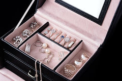 Jewelry box with white gold and silver rings, earrings and pendants with pearls. Collection of luxury jewelry. Jewelry box with white gold and silver rings Stock Photos