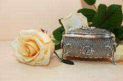 Jewelry box with white rose. Jewelry box of bright silver with a white rose Stock Photos