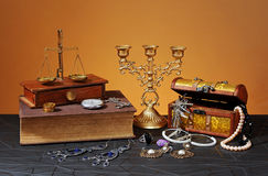 Jewelry boxes, books and candlestick Royalty Free Stock Photos