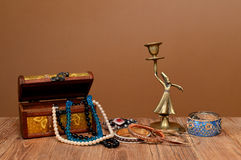 Jewelry boxes, necklaces and figures from the brass Stock Images