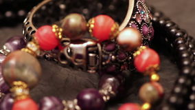 Jewelry bracelets and necklaces on the table. Various jewellery on the table stock video footage