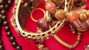 Jewelry bracelets and necklaces on the table. Various jewellery on the table stock footage