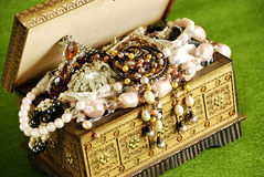 Jewelry casket. On green background Royalty Free Stock Photos