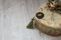 Jewelry Casket. Jewelry casket of tapestry on a wooden background stock image