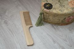 Jewelry Casket. Of tapestry and comb for hair on a wooden background Stock Photo