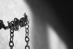 Chain wound on a nail. Jewelry chain, meaning of dangerous or strong, photography with good composition stock image