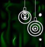 Jewelry Christmas balls. On a dark green silk are two abstract jewelry Christmas balls Royalty Free Stock Images