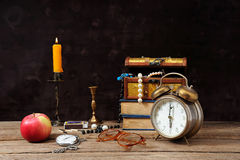 Jewelry, clocks and an apple Stock Photography