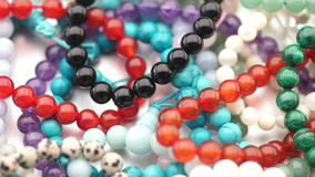 Jewelry. Colorful gemstone jewelry in a pile  turning slowly stock video footage