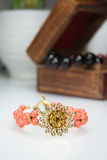 Jewelry Coral Bracelet with Filigre Flower. Coral beaded bracelet with Swarovski pearls and filigree crystal flower near wooden jewelry box stock photo