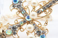 Jewelry cross. With blue and golden stones Royalty Free Stock Images