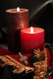 Jewelry cross with diamonds and candles Royalty Free Stock Images