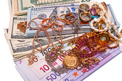 Jewelry and currency Stock Photo