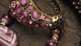 Jewelry on a dark background. Various jewellery on the table stock video footage