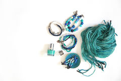 Jewelry, decorations of blue and turquoise. White background. Br Royalty Free Stock Image
