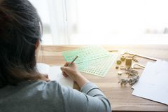 Jewelry designer. Is drawing sketch works stock image