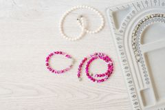 Jewelry designer workplace. Handmade, craft concept. Materials for making jewelry. Beading bracelets and necklaces settings. Freelance workspace in flat lay royalty free stock photos