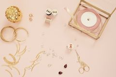 Jewelry designer workplace. Handmade, craft concept. Materials for making jewelry ? golden scissors, ribbons, gold tubes, bracelet. Settings. Freelance royalty free stock photography