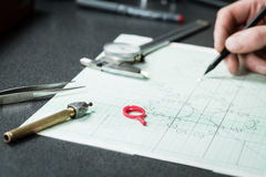 Jewelry designer works on a hand drawing sketc Royalty Free Stock Photography
