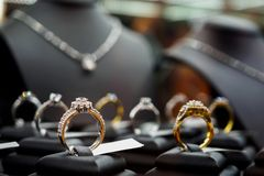 Jewelry Diamond Rings And Necklaces Show In Luxury Retail Store Royalty Free Stock Images