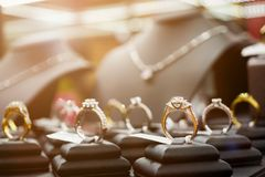 Jewelry diamond rings and necklaces show in luxury retail store. Window display showcase royalty free stock photography