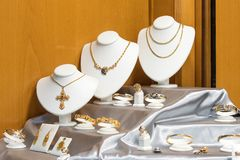 Jewelry diamond rings and necklaces show in luxury retail store window display showcase. Jewelry dond rings and necklaces show in luxury retail store window stock images