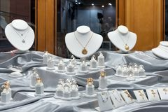 Jewelry diamond rings and necklaces show in luxury retail store window display showcase.  stock images