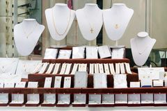 Jewelry diamond rings and necklaces show in luxury retail store window display showcase.  stock photos