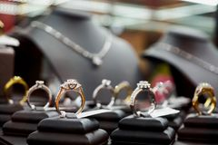 Jewelry diamond rings and necklaces show in luxury retail store. Window display showcase stock photography