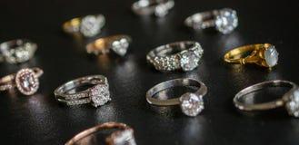 Jewelry diamond rings set on black background royalty free stock photography