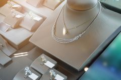 Jewelry diamond shop with rings and necklaces. Luxury retail store window display Stock Photography