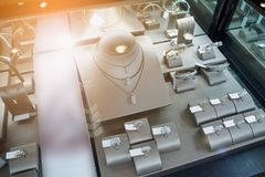 Jewelry diamond shop with rings and necklaces. Luxury retail store window display Stock Photos