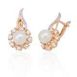 Jewelry earring with pearl and diamonds Royalty Free Stock Photos