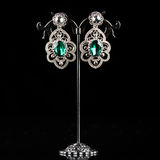Jewelry earrings with gems Royalty Free Stock Images
