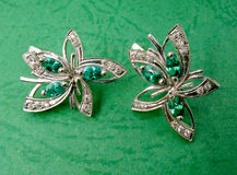 Jewelry with emerald and brilliants Stock Images