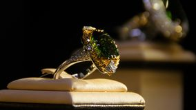 Jewelry with emeralds and diamond. Gemstones. Gold ring with emerald Royalty Free Stock Image