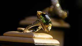 Jewelry with emeralds and diamond. Gemstones. Gold ring with emerald Royalty Free Stock Photo