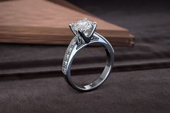 Jewelry engagement gold ring with diamonds. 3D rendering Royalty Free Stock Photo