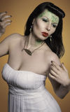 Jewelry. Female model posing with green face paint on the forehead Royalty Free Stock Image