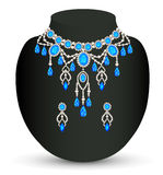 Jewelry female necklace and earrings with blue jew Stock Images